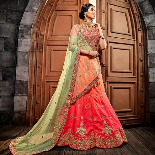 Gleaming Peach-Pink Colored Wedding Wear Heavy Embroidered Silk Lehenga