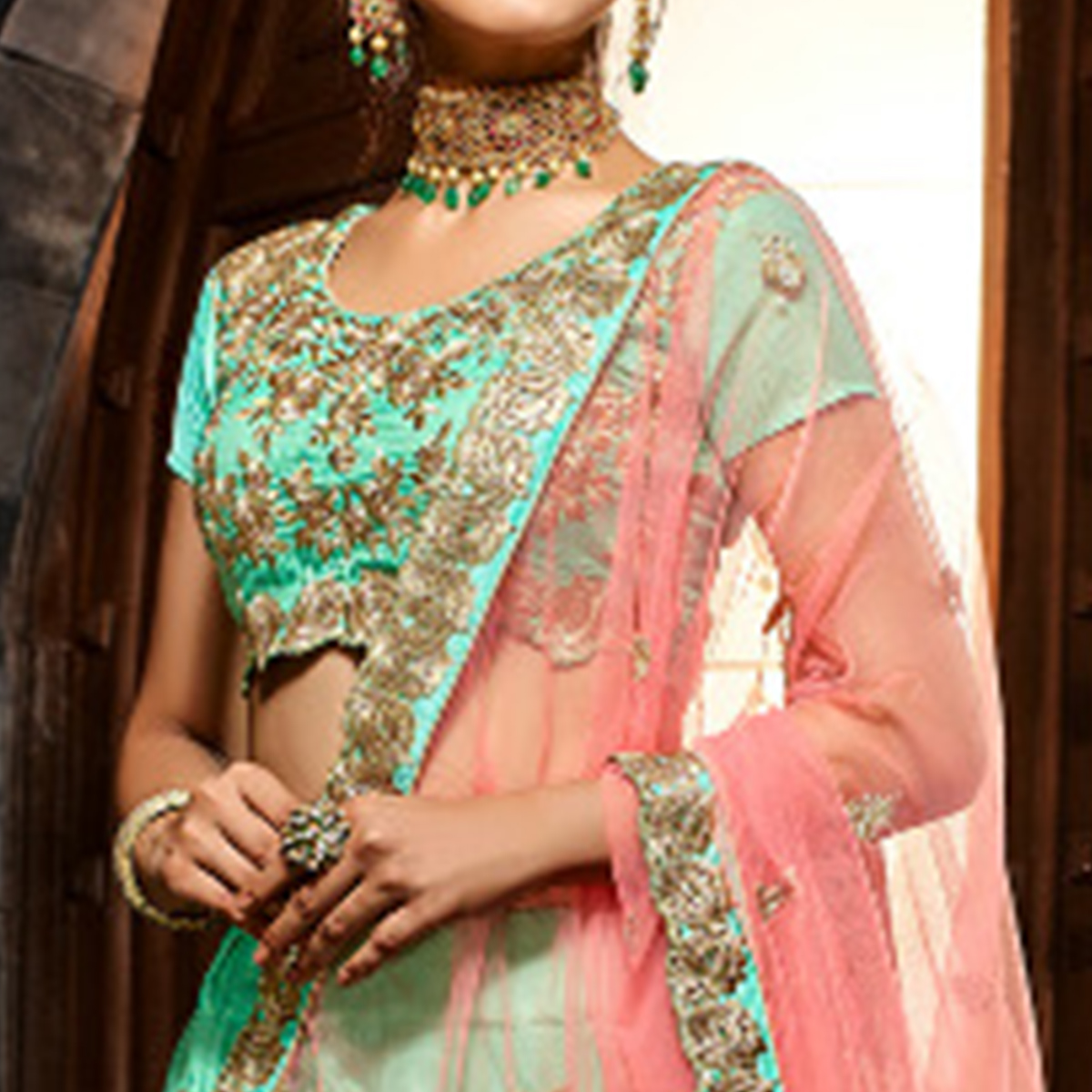 Arresting Turquoise Colored Wedding Wear Heavy Embroidered Silk Lehenga