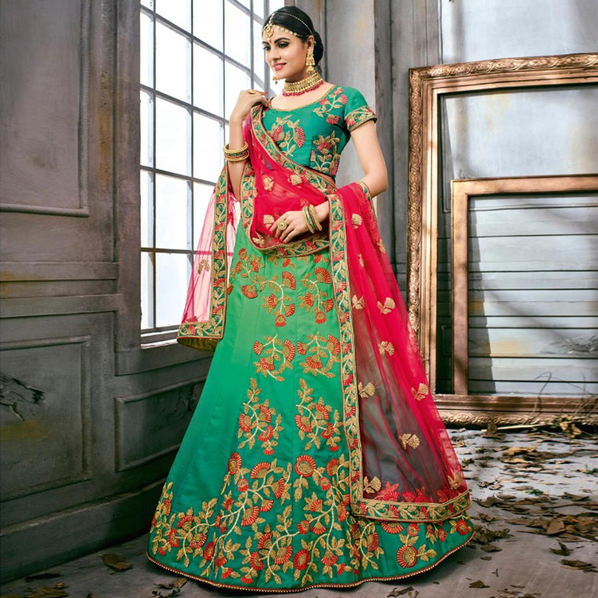 Glowing Turquoise Green Colored Partywear Embroidered Art Silk Lehenga Choli