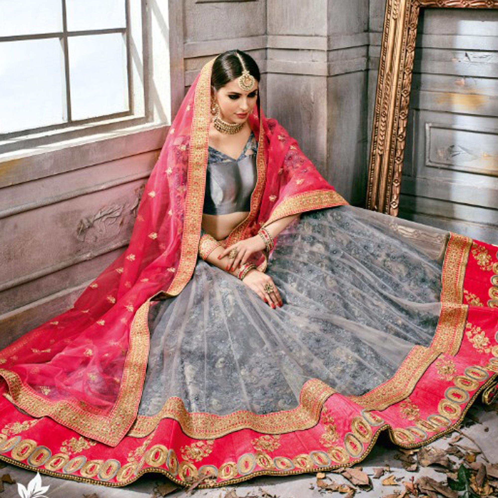 Demanding Gray Colored Partywear Embroidered Netted Lehenga Choli