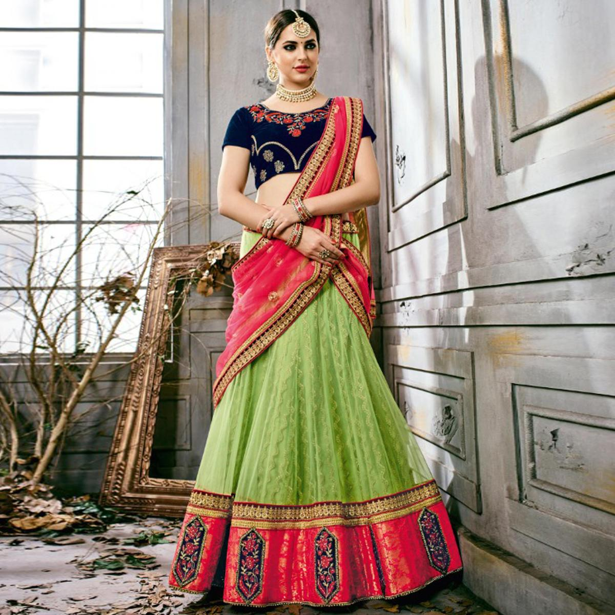 Marvellous Green-Navy Blue Colored Partywear Embroidered Netted Lehenga Choli