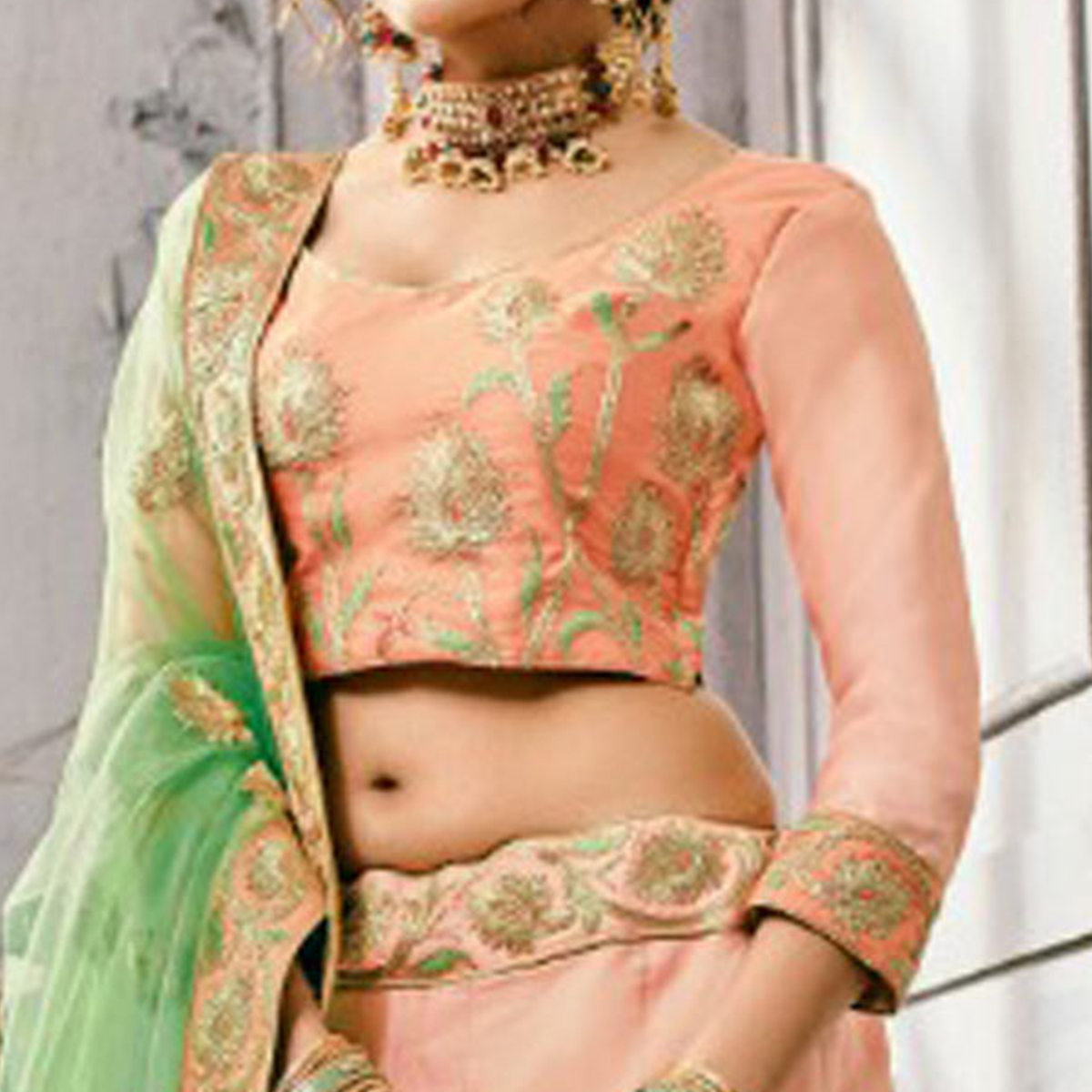 Pleasant Light Peach Colored Partywear Embroidered Art Silk Lehenga Choli