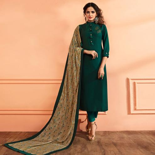 Arresting Dark Green Colored Partywear Embroidered Muslin Cotton Suit