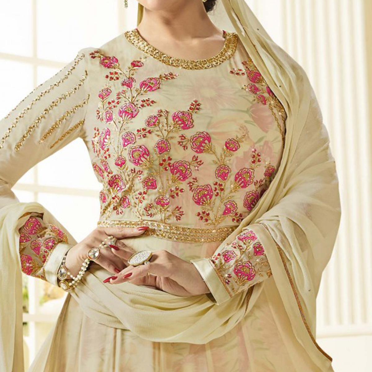 Opulent Cream Colored Party Wear Embroidered Faux Georgette Anarkali Suit