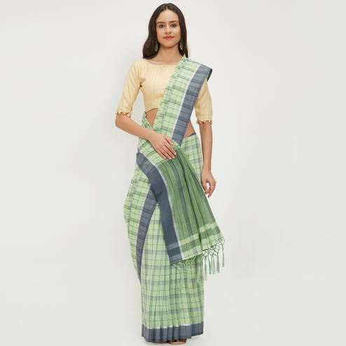 Attractive Green Colored Casual Wear Linen Saree With 2 Blouse Pieces