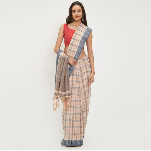 Adorning Peach Colored Casual Wear Linen Saree With 2 Blouse Pieces