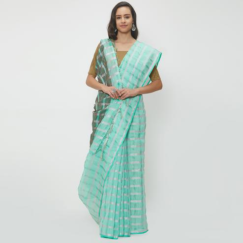 Refreshing Aqua Blue Colored Casual Wear Linen Saree With 2 Blouse Pieces