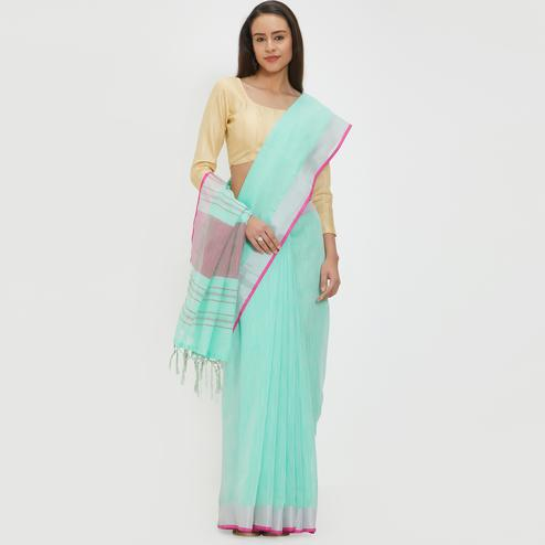 Flattering Aqua Blue Colored Casual Wear Linen Saree With 2 Blouse Pieces