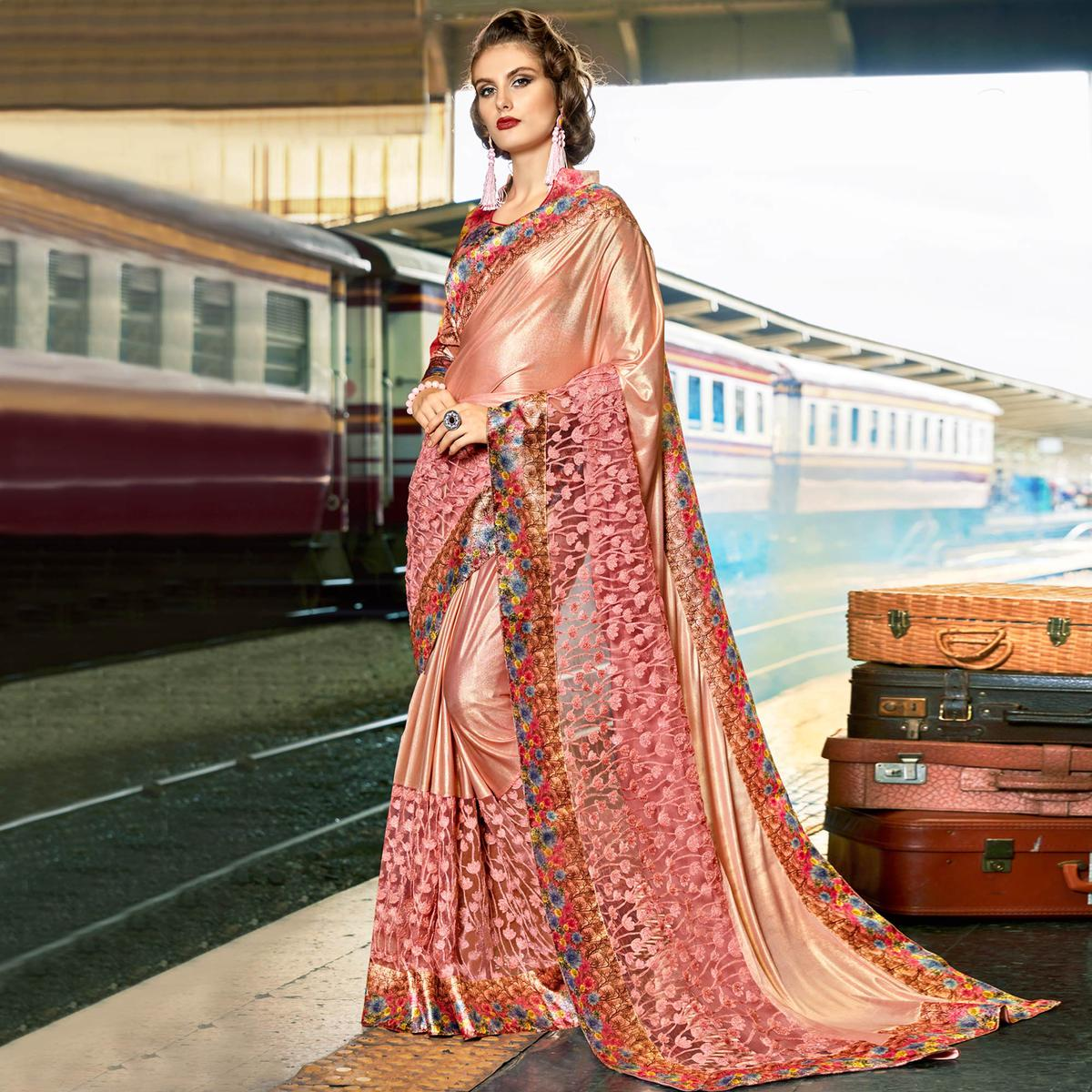 Capricious Dusty Pink Colored Party Wear Printed Lycra & Net Saree