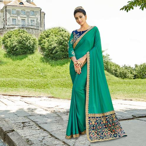 Ravishing Teal Green Colored Party Wear Embroidered Satin Silk Saree