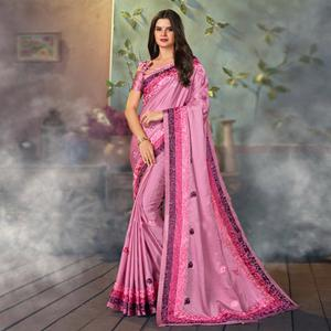 Stunning Pink Colored Partywear Embroidered Satin Saree