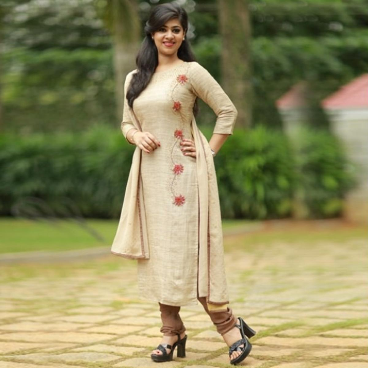 Impressive Beige Colored Embroidered Cotton Jute Kurti