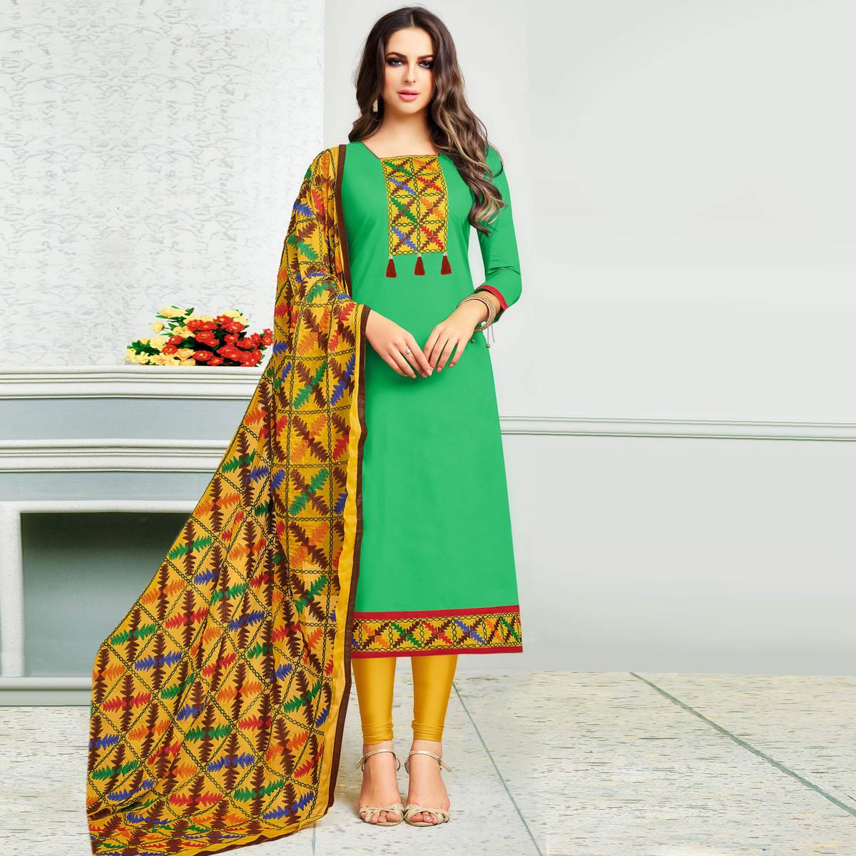 Glorious Green Colored Partywear Embroidered Cotton Dress Material