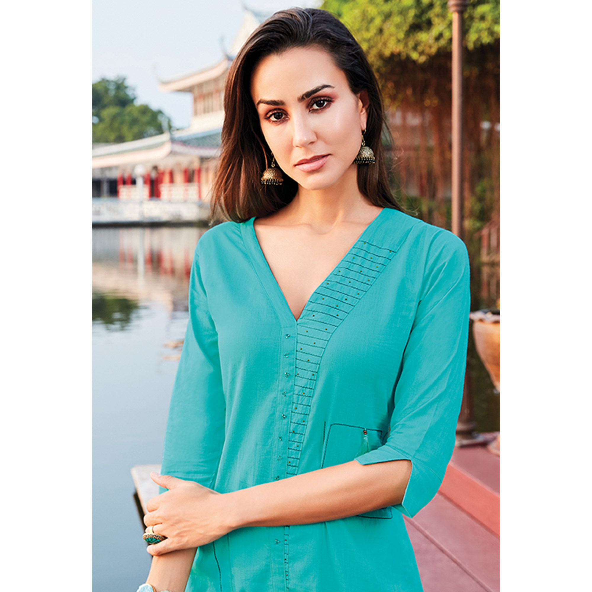 Flirty Turquoise Blue Colored Party Wear Cotton Silk Kurti
