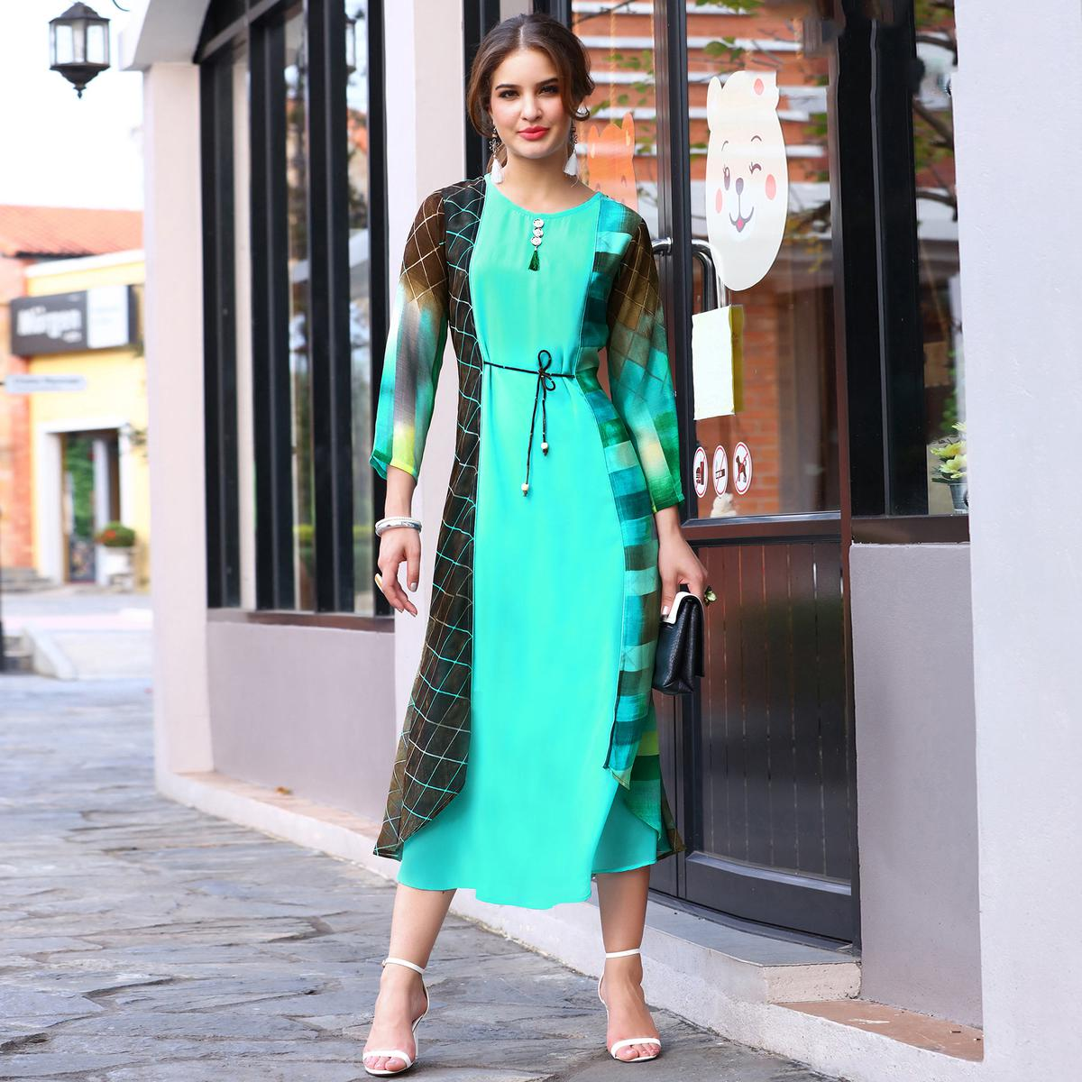Stylish Aqua Green Colored Partywear Printed Georgette Kurti