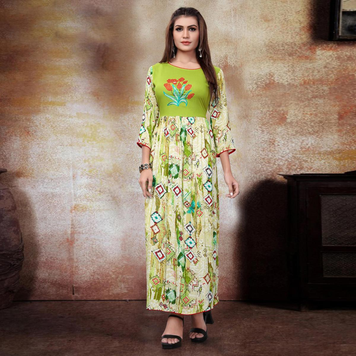 Classy Cream-Parrot Colored Party Wear Printed Fancy Heavy Rayon Kurti