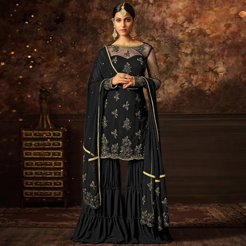 Adorning Black Colored Party Wear Embroidered Net Palazzo Suit