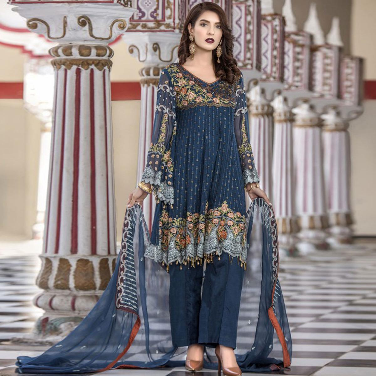 Flattering Steel Blue Colored Party Wear Heavy Embroidered Georgette Suit