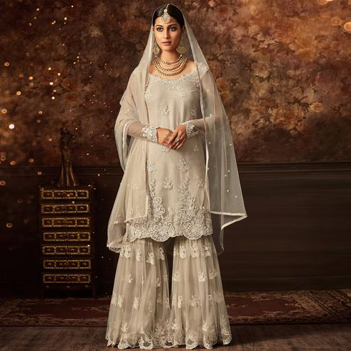 Appealing White Colored Partywear Embroidered Netted Palazzo Suit