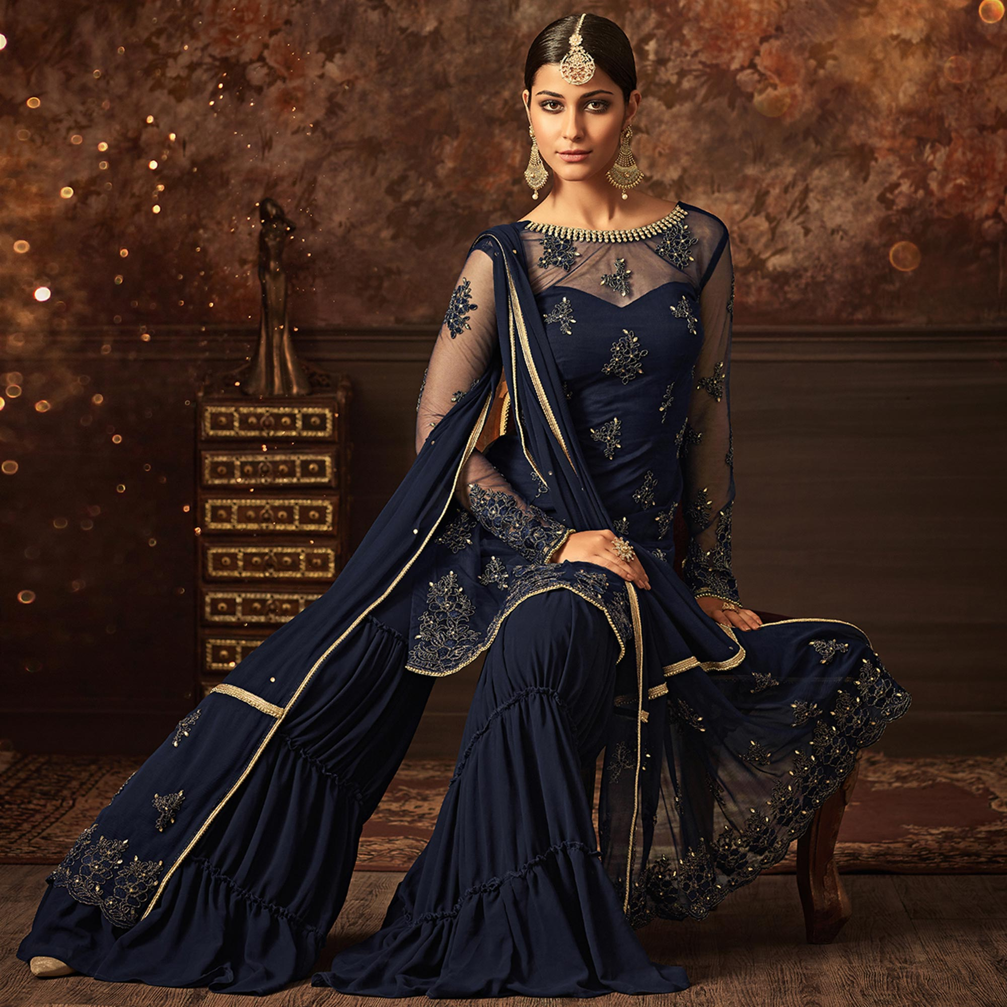 Hypnotic Navy Blue Colored Partywear Embroidered Netted Palazzo Suit