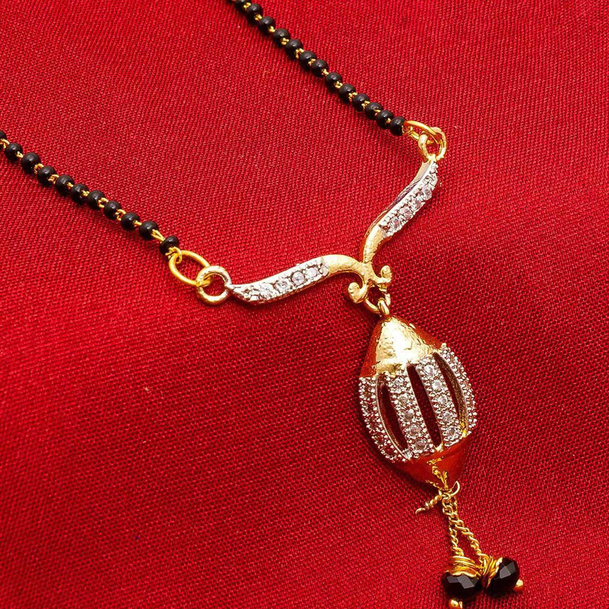 Adorning Golden Colored Mix Metal & Diamond Work Mangalsutra