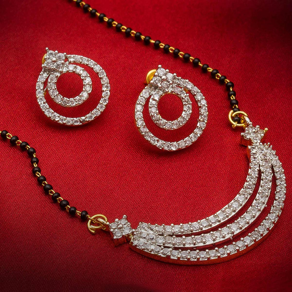Groovy Golden Colored Mix Metal & Diamond Work Mangalsutra With Earring Set