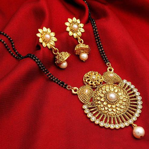 Prominent Golden Colored Mix Metal & Diamond Work Mangalsutra With Earring Set