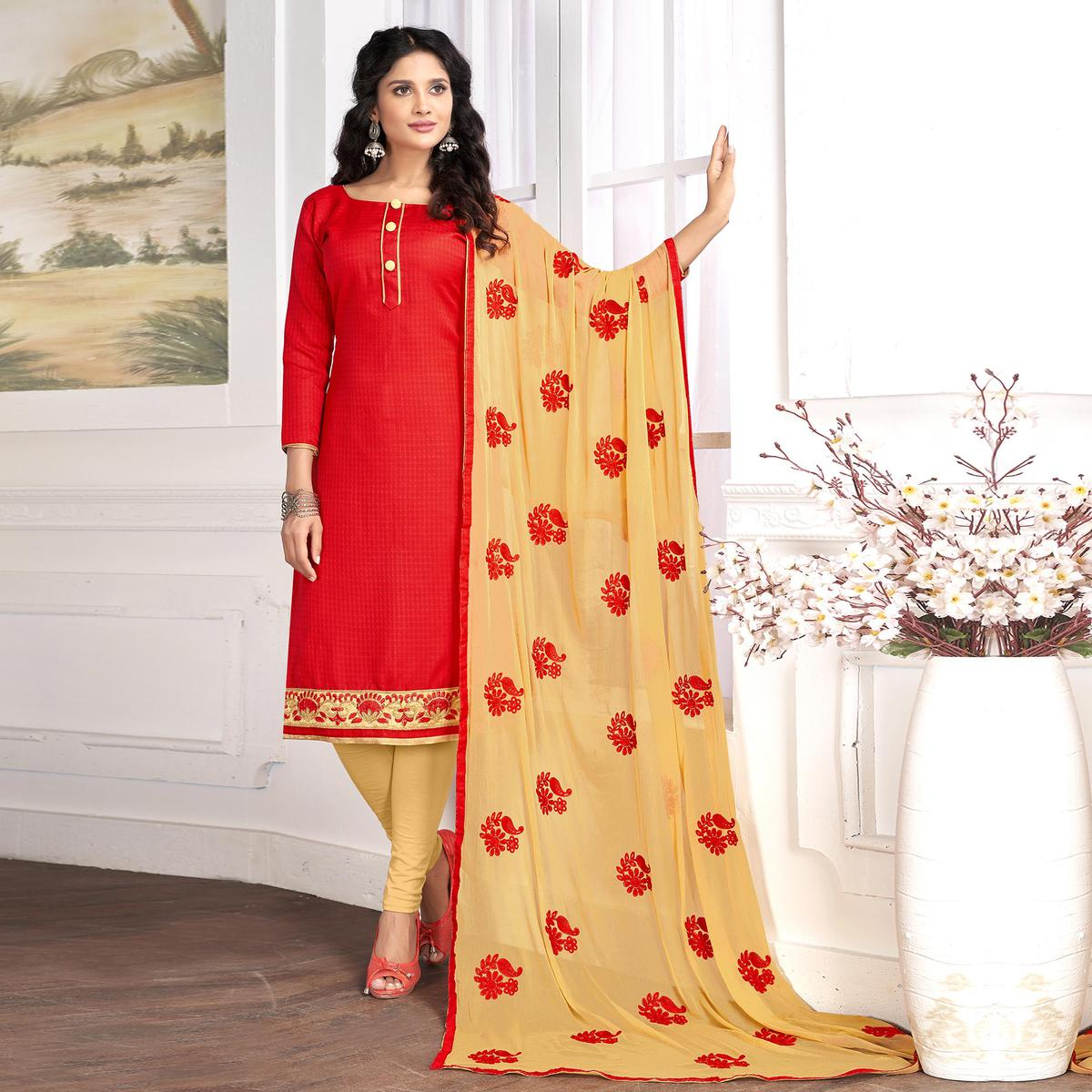 Gleaming Red Colored Partywear Embroidered Cotton Suit