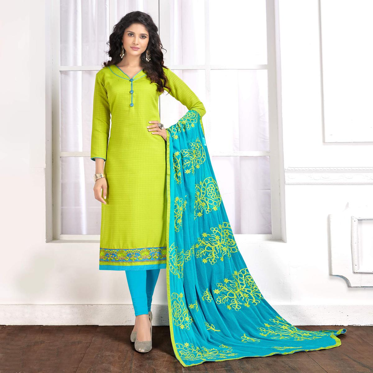Blooming Lemon Green Colored Partywear Embroidered Cotton Suit
