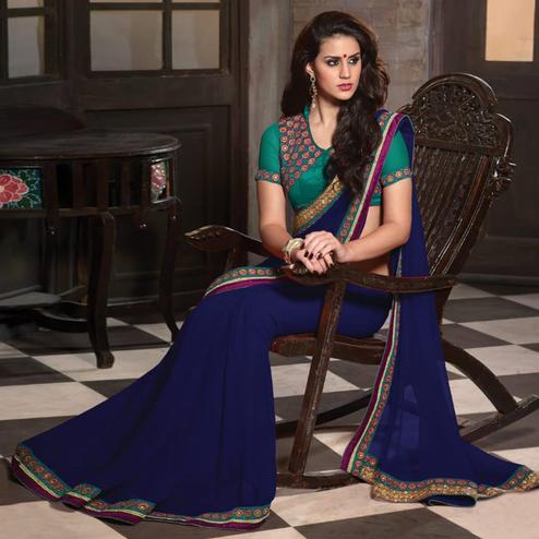 Pretty Blue Colored Party Wear Embroidered Georgette Saree