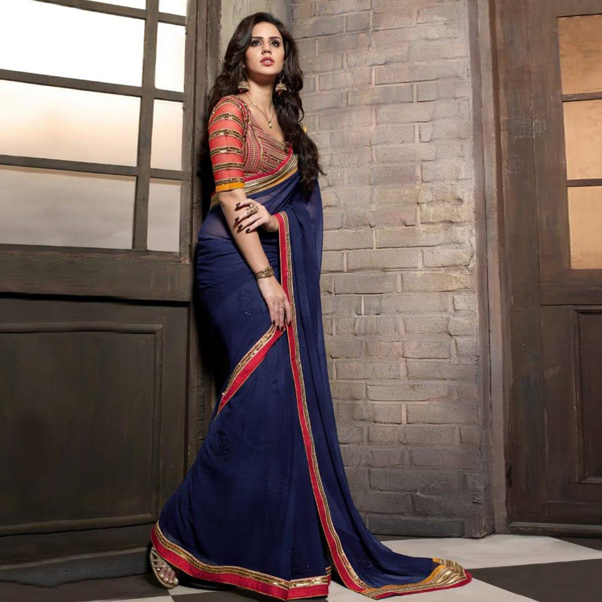 Delightful Blue Colored Party Wear Embroidered Georgette Saree