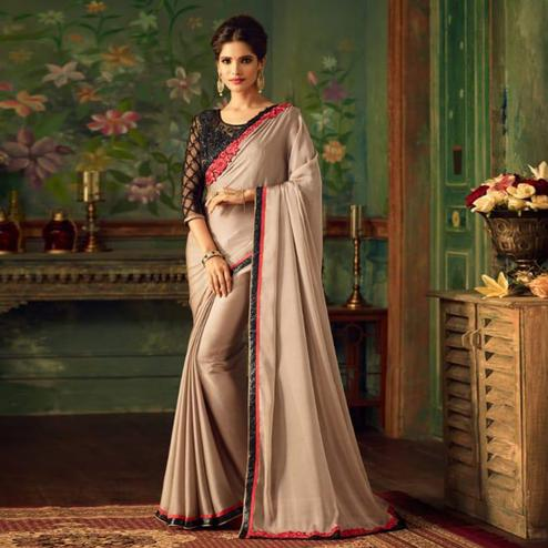 Exotic Beige Colored Party Wear Embroidered Silk Saree