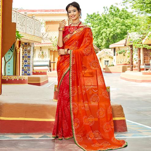 Engrossing Orange & Red Colored Party Wear Embroidered Georgette Saree