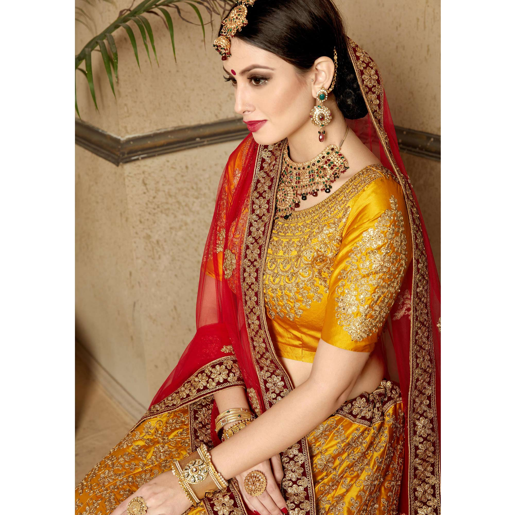 Glowing Mustard Yellow Colored Wedding Wear Embroidered Satin Lehenga Choli