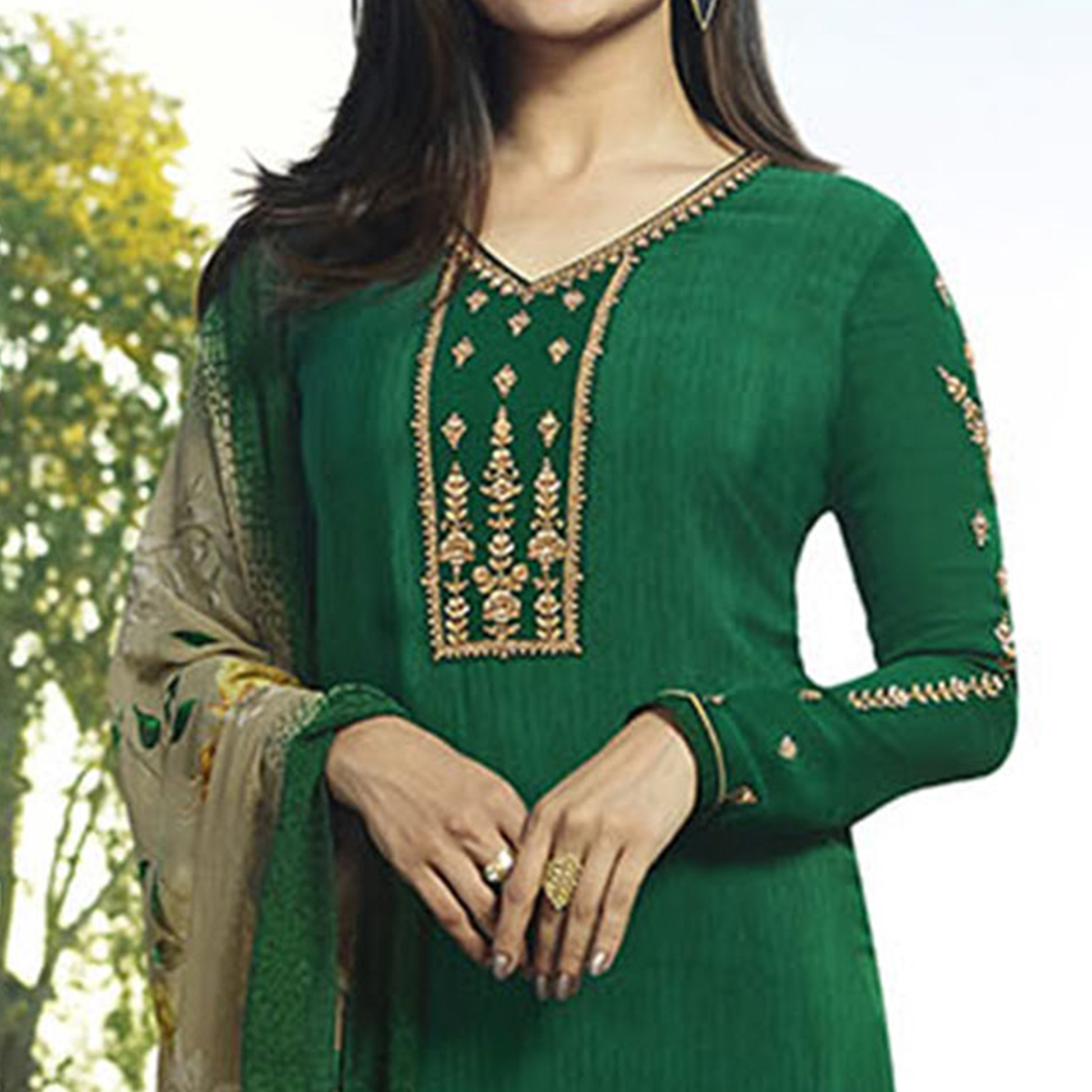 Stunning Green Colored Partywear Embroidered Crepe Suit