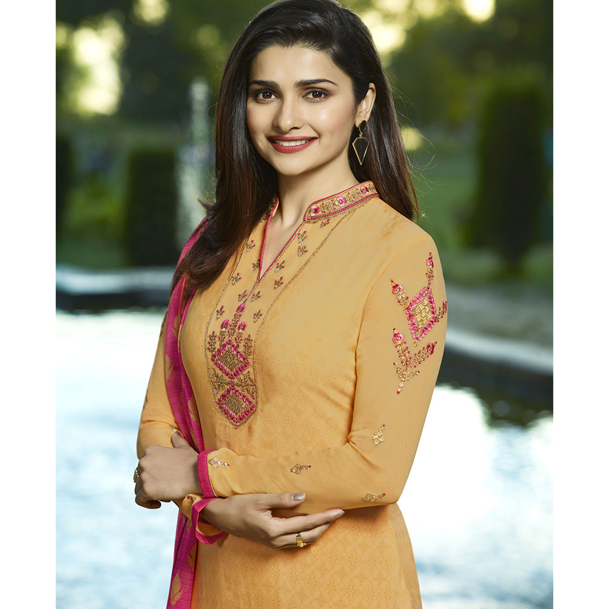 Glowing Yellow Colored Partywear Embroidered Crepe Suit