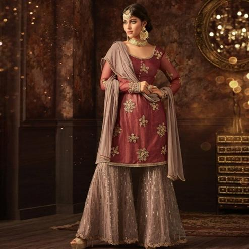 Imposing Dark Mauve Colored Party Wear Embroidered Soft Net Palazzo Suit
