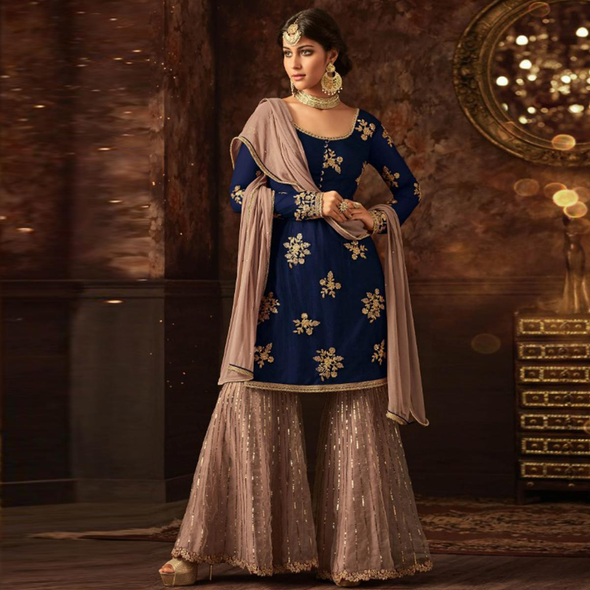 Blissful Navy Blue Colored Party Wear Embroidered Soft Net Palazzo Suit