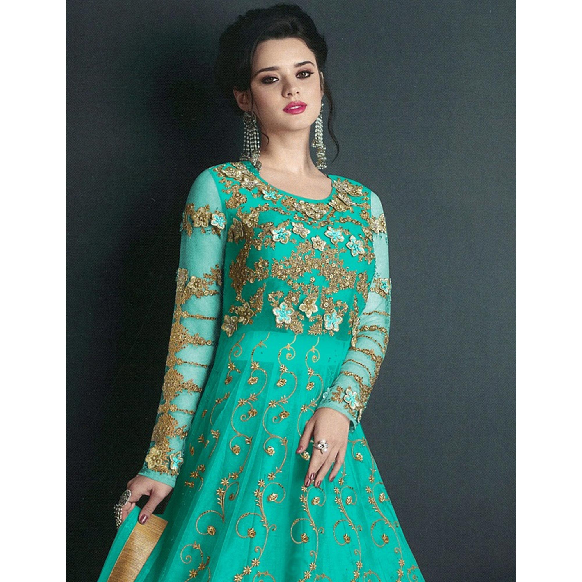 Graceful Turquoise Colored Partywear Embroidered Net Lehenga Kameez