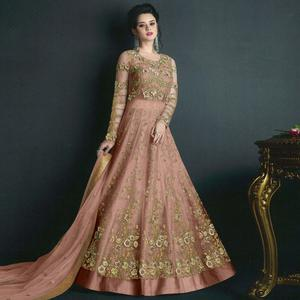 Stunning Peach Colored Partywear Embroidered Net Lehenga Kameez