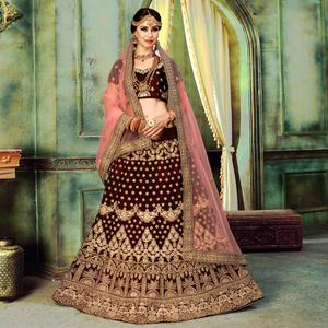 Attractive Maroon Colored Wedding Wear Embroidered Velvet Lehenga Choli
