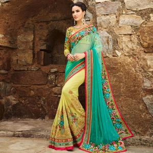 Groovy Firozi-Yellow Colored Party Wear Embroidered Georgette Saree