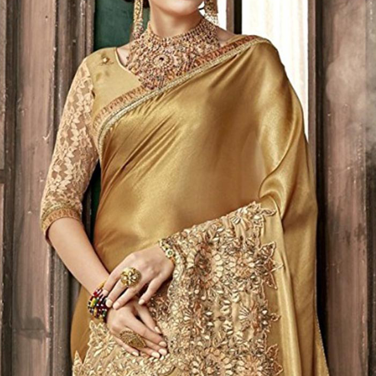 Glowing Golden Colored Party Wear Embroidered Silk Saree