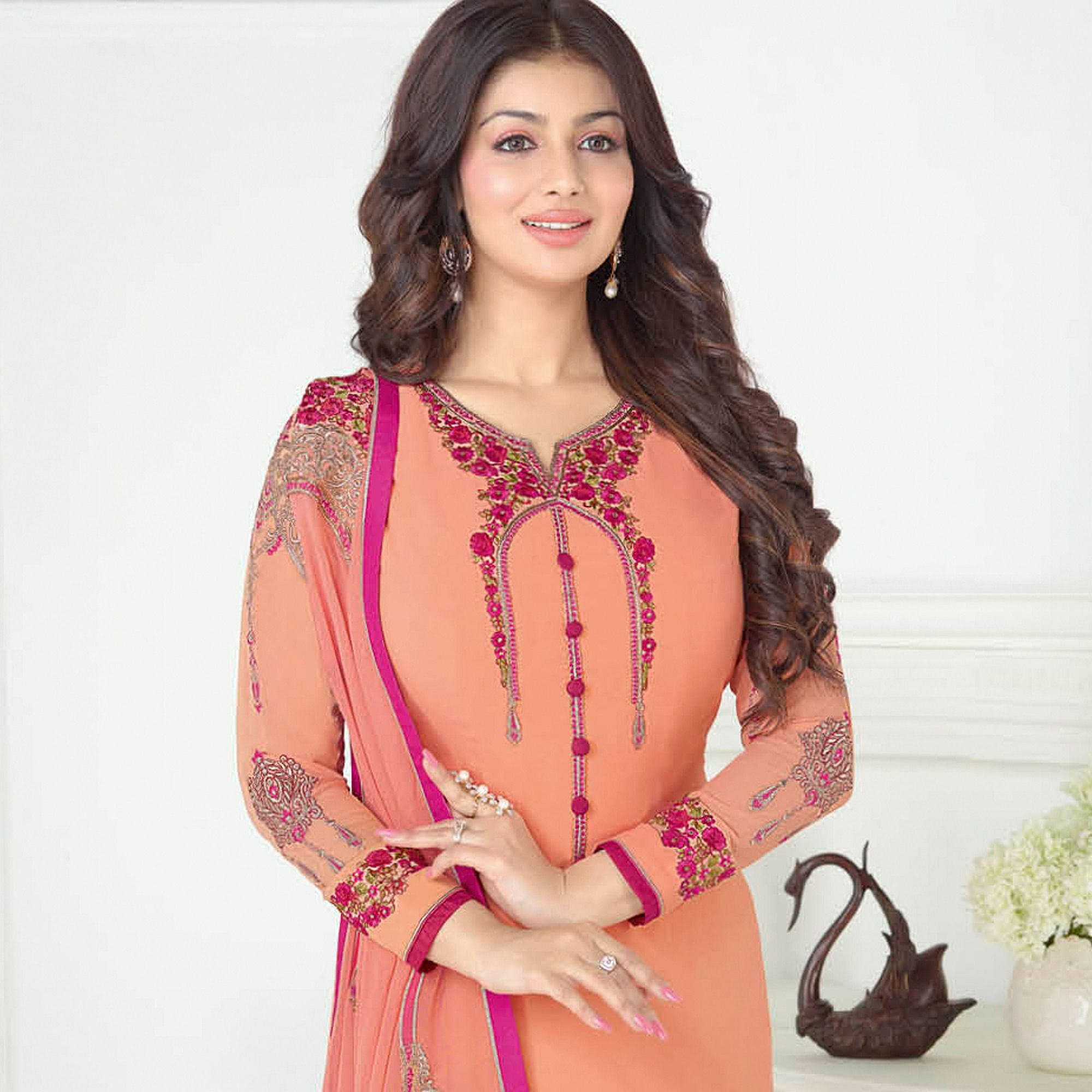 Fabulous Peach Colored Partywear Embroidered Georgette Suit