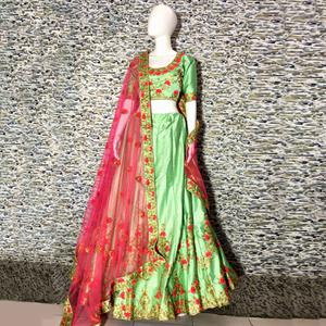 Gorgeous Sea Green Colored Embroidered Party Wear Satin Lehenga Choli