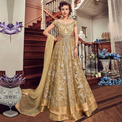 Ravishing Beige Colored Wedding Wear Embroidered Net Lehenga Kameez