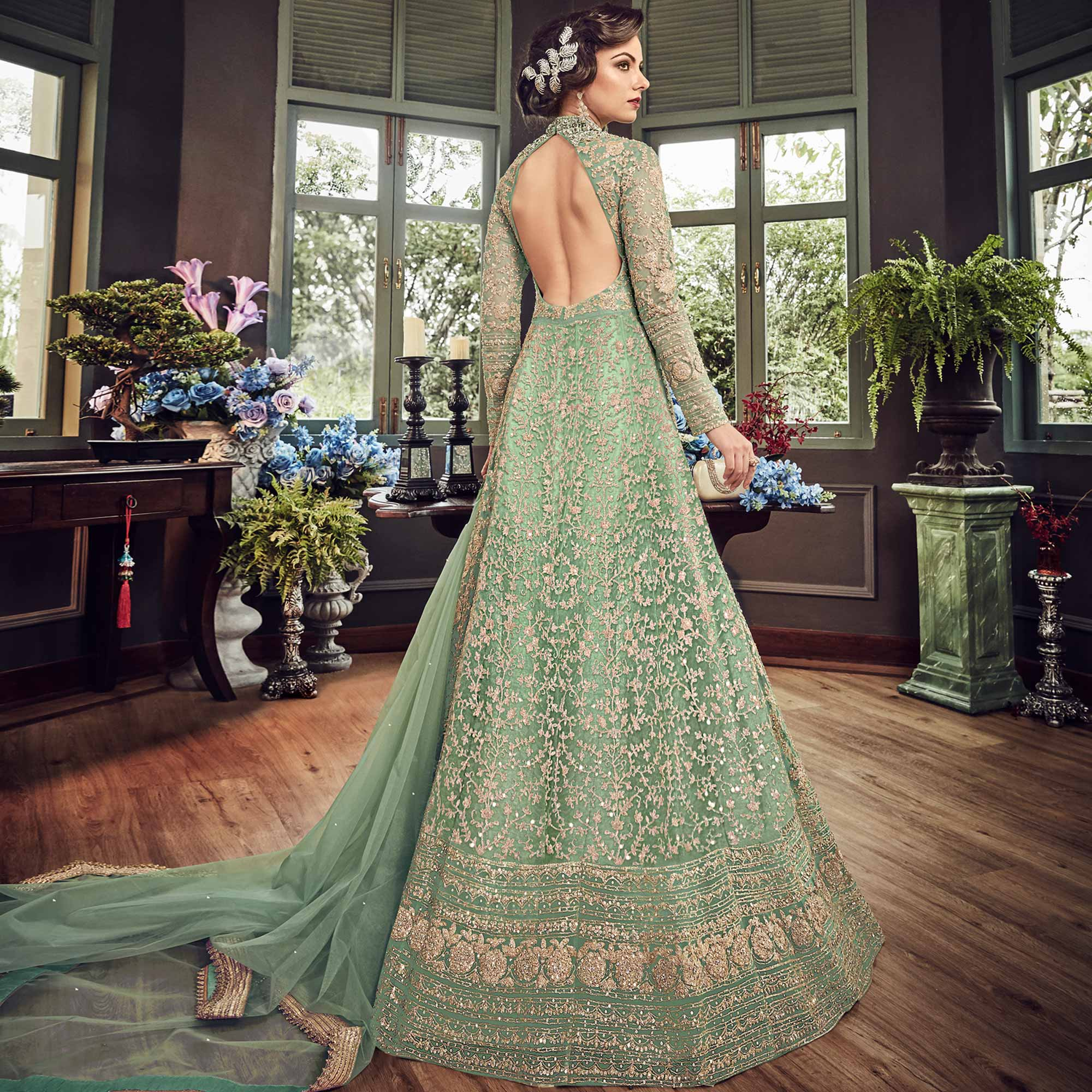 Gorgeous Green Colored Wedding Wear Embroidered Net Lehenga Kameez