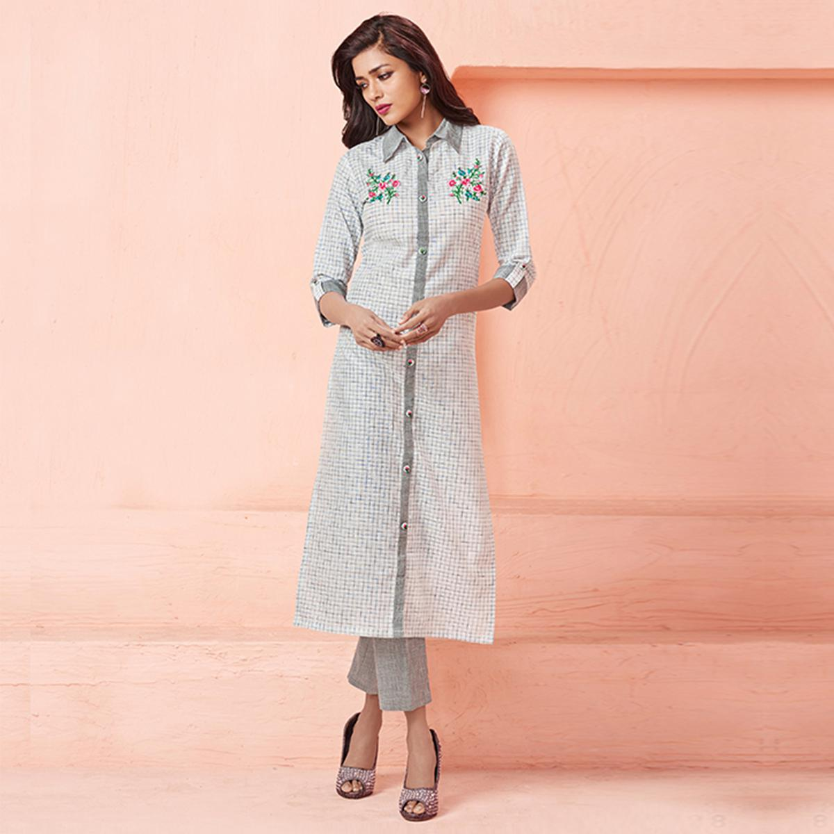 Charming Off White Colored Casual Wear Embroidered Linen Kurti