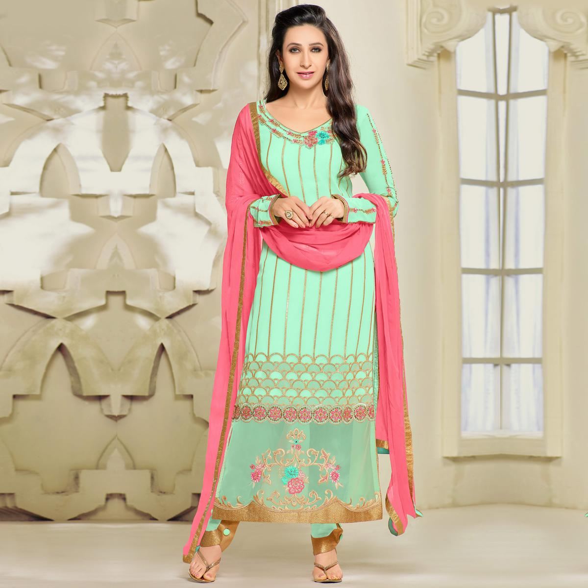 Alluring Sea Green Colored Party Wear Embroidered Georgette Suit