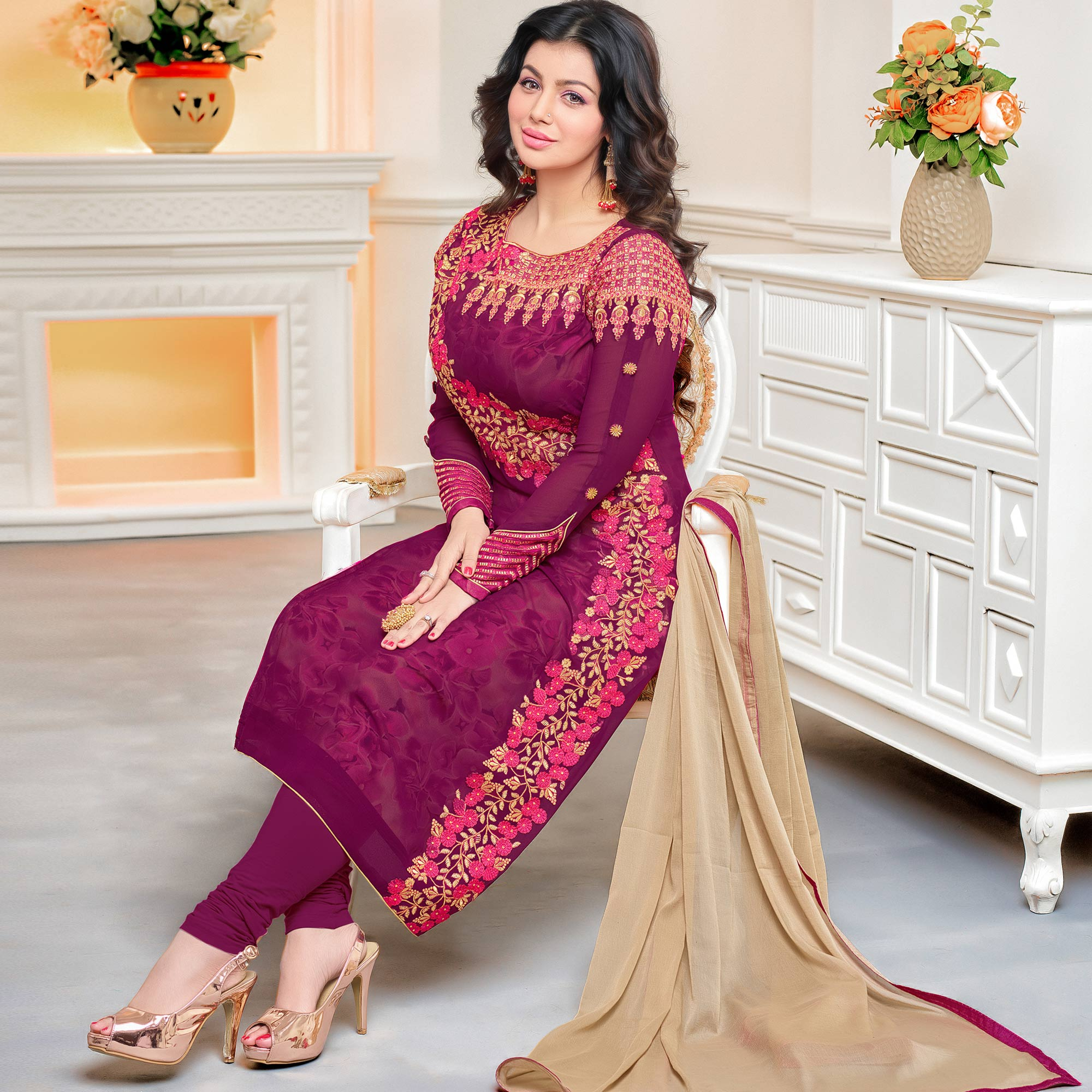 Capricious Purple Colored Party Wear Embroidered Georgette Suit